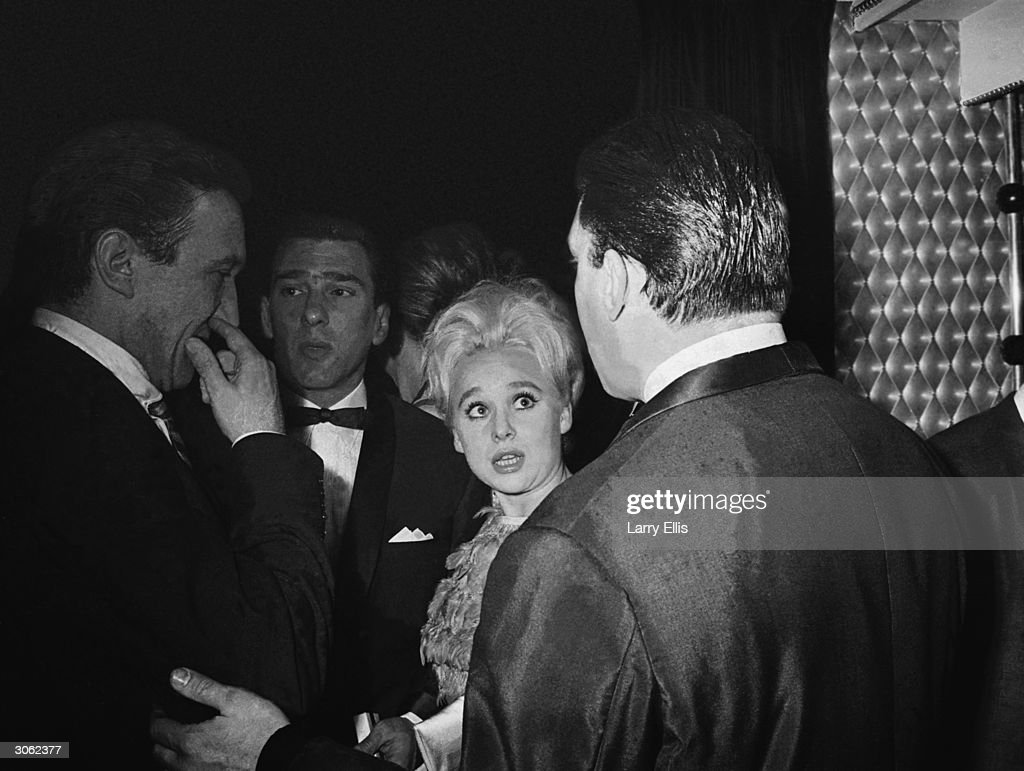 From left to right, actor George Sewell, London gangster Reggie Kray, actress Barbara Windsor and Reggie's brother Ronnie Kray, at the El Morocco nightclub.
