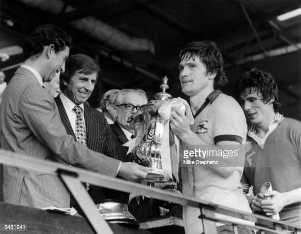 Prince Charles presenting Arsenal captain Pat Rice with the FA Cup after his team beat Manchester United 32 Frank Stapleton who scored during the...