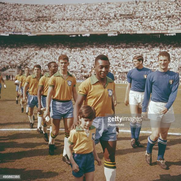 Pele leads the Brazil national team out on to the pitch before the international game with Italy at the San Siro stadium in Milan Italy on 12th May...