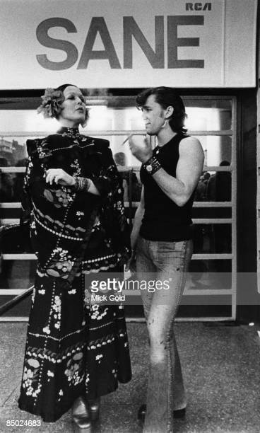 Two fans pose outside the Earls Court concert venue during David Bowie's 'Aladdin Sane' Tour in London on 12th May 1973