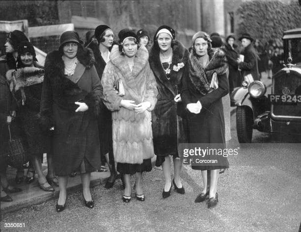 Some of the tennis players attending the wedding between British tennis player Joan Fry and Thomas Lakeman at the Holy Trinity Church Brompton Left...