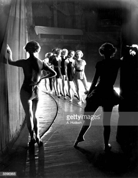 Dancers waiting in the wings during rehearsals for the pantomime 'Cinderella' to be performed at The Coliseum St Martin's Lane London