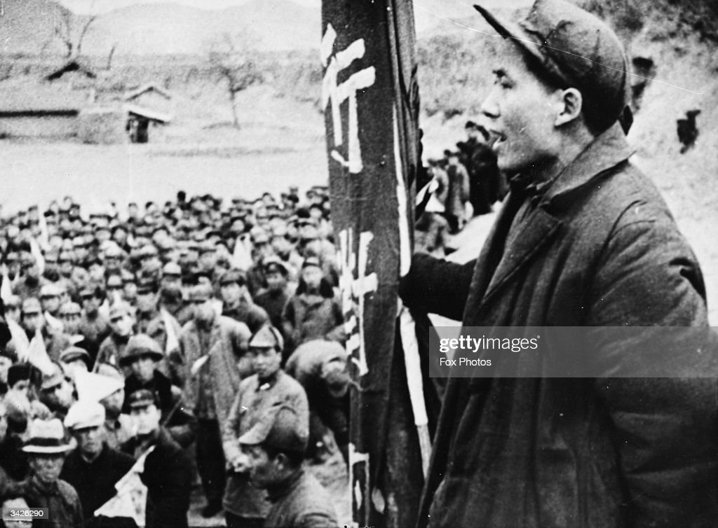 Chinese communist guerrilla leader Mao Tse-Tung, the future President of communist China and chairman of the Communist Party, addressing a meeting.