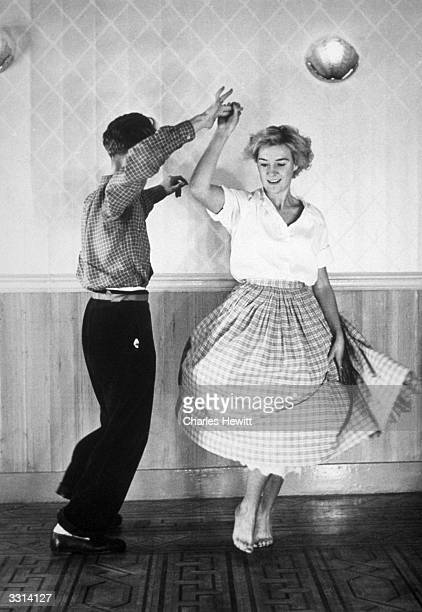 A couple dancing the Jitterbug Original Publication Picture Post 4919 A New Jazz Age pub 1949