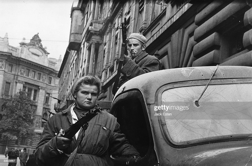 A couple of Hungarian freedom fighters bearing arms in Budapest, in preparation for the Russian forces. Original Publication: Picture Post - 8730 - Hungary's Last Battle For Freedom - pub. 1956
