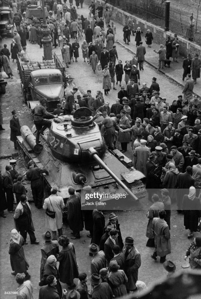 Curious crowds surround a captured Russian tank in Hungary during the uprising against the Russians. Original Publication: Picture Post - 8730 - Hungary's Last Battle For Freedom - pub. 1956