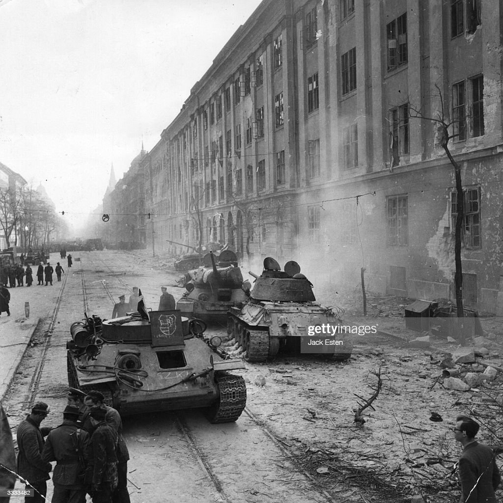 Devastation outside the Kilian Barracks, Budapest, which were in the thick of the fiercest fighting, during Russia's suppression of the Hungarian Revolution against Communist control. Original Publication: Picture Post - 8730 - Hungary's Last Battle For Freedom - pub. 1956
