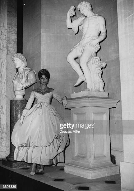 Victoire Therond wears 'Zaire' a gown from the new collection by Christian Dior to be shown to Princess Margaret in a special preview at Blenheim...
