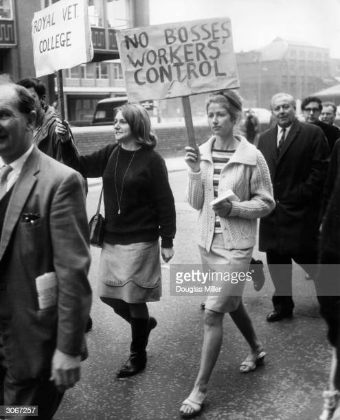 Two women carry banners during a protest march to London University's Senate House They are some of the 5000 laboratory technicians striking for more...