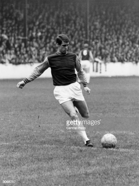 Footballer Geoff Hurst playing for West Ham United