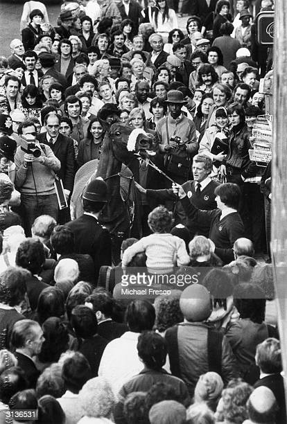 Crowds watching the racehorse Red Rum at the opening of a betting shop in Kilburn London