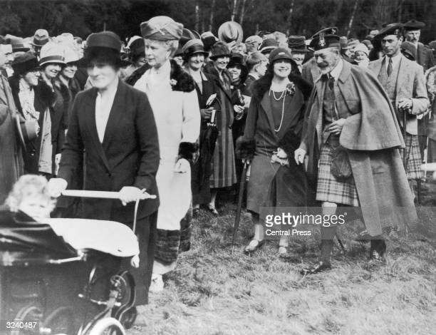 Elizabeth Duchess of York talking to King George V at a fete held in the grounds of Balmoral Castle in aid of the Crathie Parish Hal Fund and local...