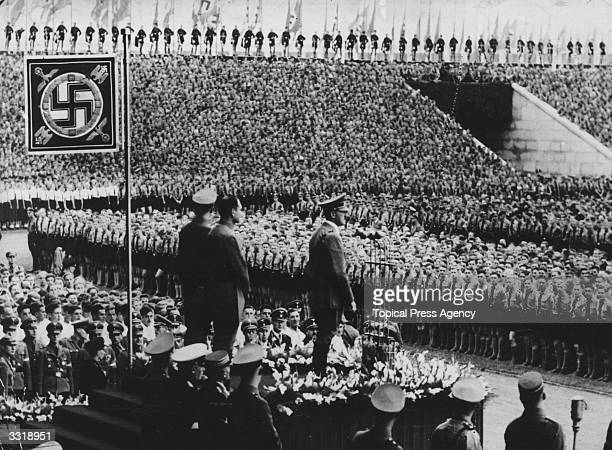 Nazi German dictator Adolf Hitler addresses members of the Hitler Youth Movement at Nuremberg Behind the Fuhrer are Baldur Von Schirach leader of the...