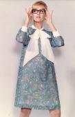 A model wearing a paisley patterned Aline minidress