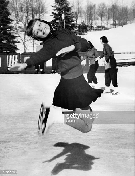 12yearold Carol Heiss the US national junior women's figure skating champion smiles as she jumps during training at the Grossinger country club's...