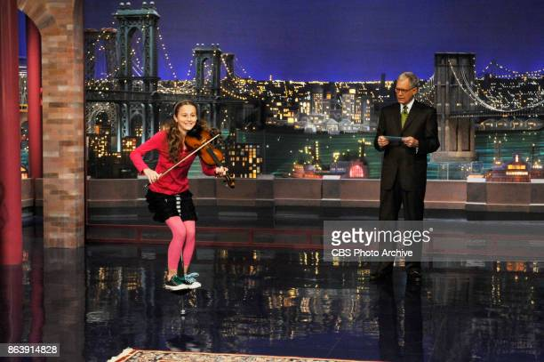 12yearold Dea Devlin from Brooklyn NY jumps on a pogo stick and plays a violin while David Letterman looks on during Stupid Human Tricks on the LATE...