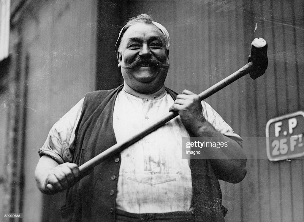 Blacksmith Tom Teece 'Tiny Tim' to his workmates in the smithy at the LMS Locomotive works at Crewe He weighs 25 ½ stones and has worked in Crewe for...