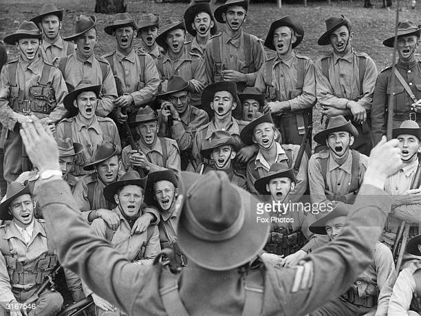 Militiamen of the 59th Battalion Hume Regiment singing the Australian folk song 'Where the Dog Sat on the Tucker Box'