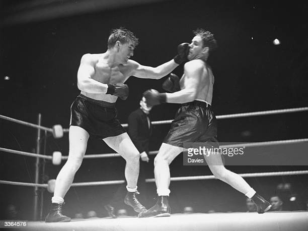 Welsh heavyweight boxing champion Tommy Farr punching Clarence Burman during an international heavyweight contest at Harringay Arena London