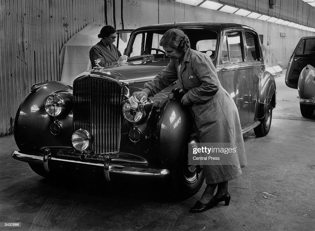 A Bentley receiving its final polish from women workers in the despatch bay at the Rolls Royce factory Crewe