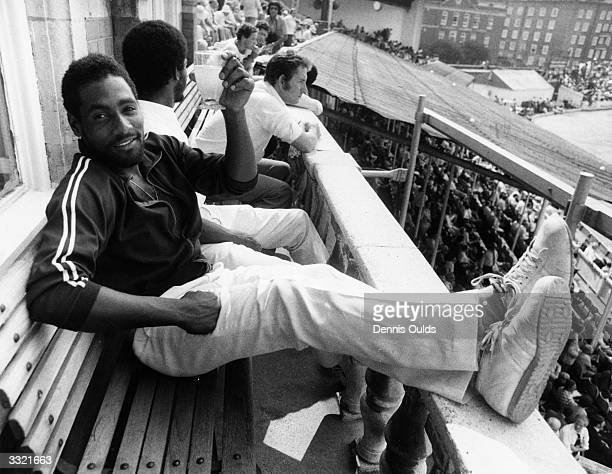 Cricketer Viv Richards relaxes with a cold drink on the balcony at the Oval after his innings of 291for the West Indies in the final Test match...