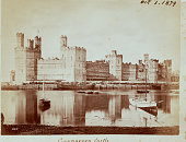 13th century castle at Carnarvon Wales reflected in a lake 1879