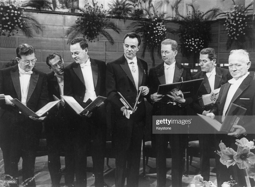 A group of Nobel prize winners after the presentation ceremony in Stockholm, (from left) Professor R B Woodward who won the prize for chemistry, Professor Julian Schwinger and Professor Richard Feynman, the winners of the prize for physics, Professor Francois Jacob, Professor Andre Lwoff and Jacques Monod, the winners of the prize for medicine and the author Mikhail Sholokhov, the winner of the prize for literature.