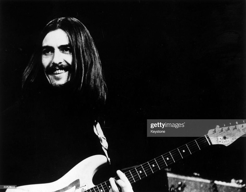<a gi-track='captionPersonalityLinkClicked' href=/galleries/search?phrase=George+Harrison&family=editorial&specificpeople=90945 ng-click='$event.stopPropagation()'>George Harrison</a> (1943 - 2001) of the Beatles at a concert in Copenhagen with Eric Clapton and Delaney and Bonnie.