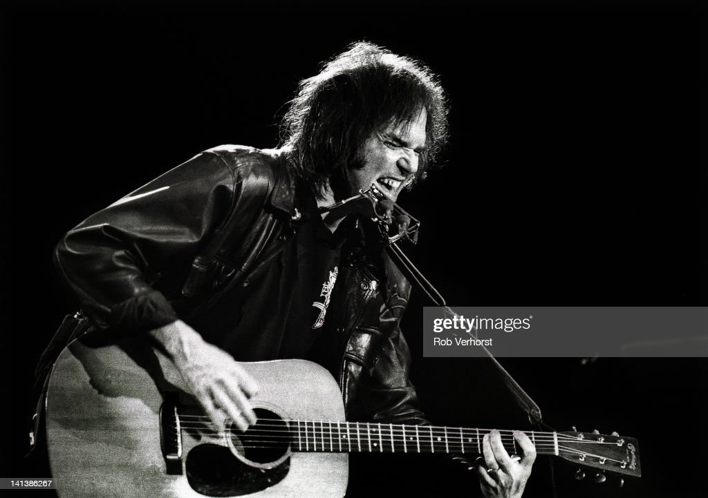 Canadian singer-songwriter Neil Young performs live on stage at Ahoy in Rotterdam, Netherlands on 13th December 1989.