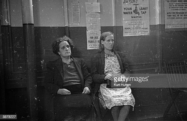 Two women waiting at the Citizens' Advice Bureau at Poplar east London to see an adviser Both have lost their clothing coupons and need help with the...