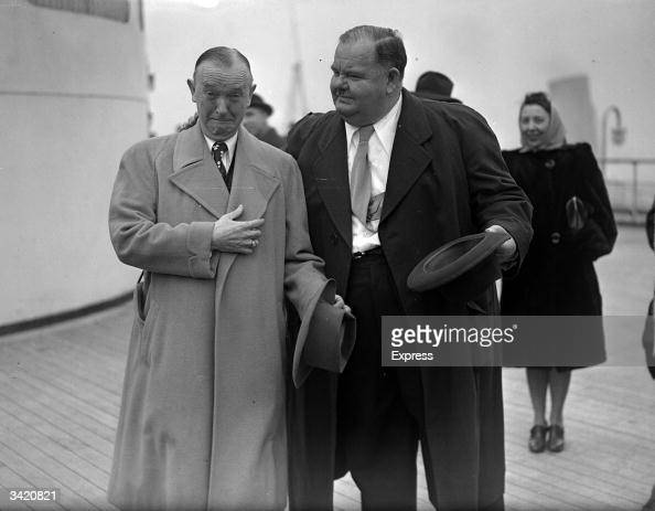 American film star and comedian Oliver Hardy with his British born partner Stan Laurel on board a ship in England