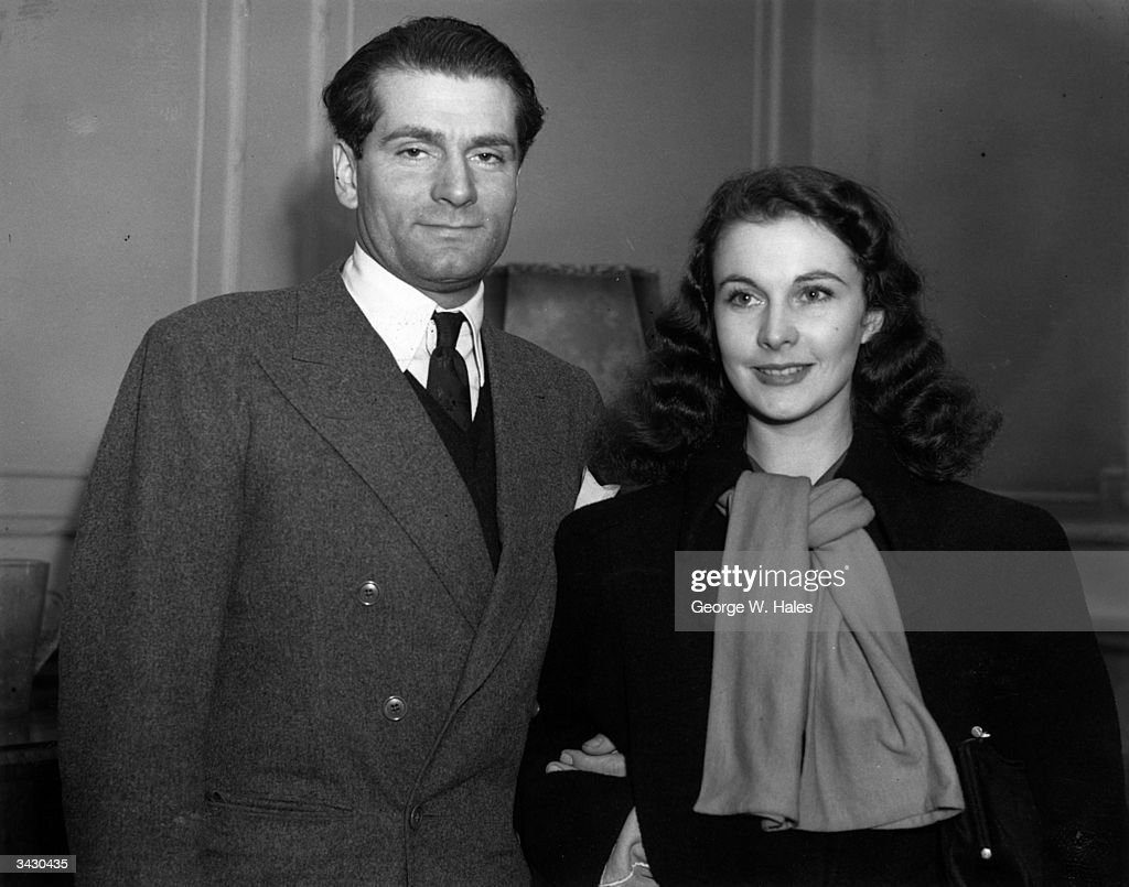 Actor Laurence Olivier (1907 - 1989) with his wife, actress Vivien Leigh (Vivian Mary Hartley) (1913 - 1967) after their arrival in England from Hollywood to play their part in WW II. Olivier hopes to join the RAF and Vivien Leigh intends to join a touring company.