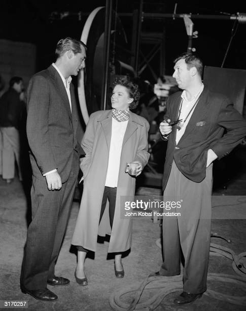 During a break from filming 'Summer Stock' Judy Garland visits Cary Grant and film director Richard Brooks on the set of the drama 'Crisis'