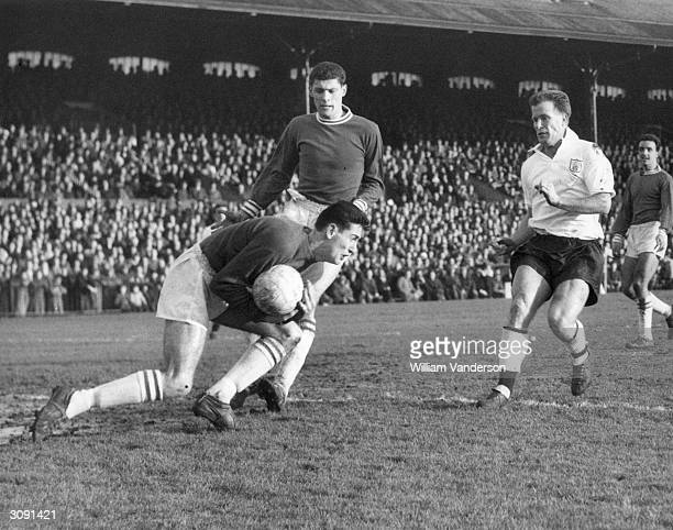 Chelsea goalkeeper Peter Bonetti runs out to save a goal from Fulham's new £14000 signing Jackie Henderson while Alan Young covers Bonetti at...
