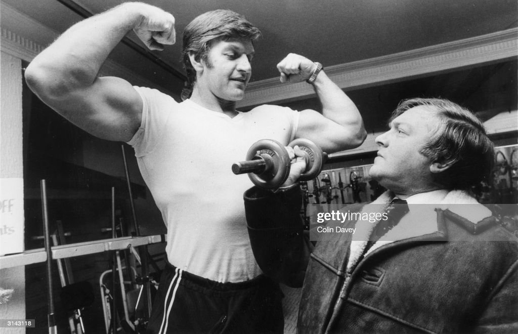 A potential client admires Dave Prowse who works in the keep-fit department of Harrods. He also plays the role of Darth Vader in Star Wars.