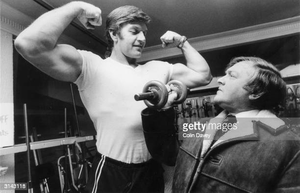 A potential client admires Dave Prowse who works in the keepfit department of Harrods He also plays the role of Darth Vader in Star Wars