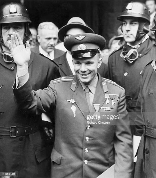 Russian Cosmonaut Yuri Gagarin the first man in space waves to crowds during a visit to London