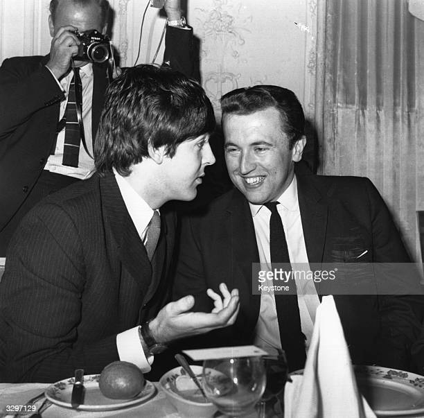 Paul McCartney chats to television presenter David Frost at the Ivor Novello Music Awards Luncheon at the Savoy Hotel London