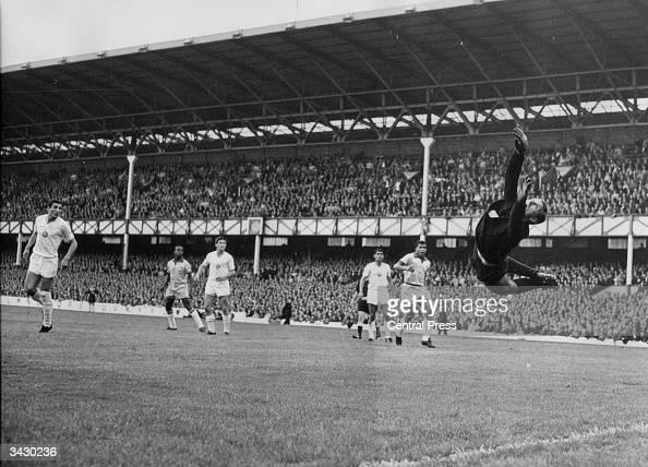The Bulgarian goalkeeper Georgi Naidenov leaping for the ball after the Brazilian footballer Garrincha scores at Goodison Park Liverpool