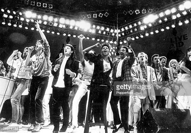 13th July 1985 Wembley London Liveaid with Bob Geldof who leads his fellow artistes in the finale at Wembley This was in aid of the African famine...