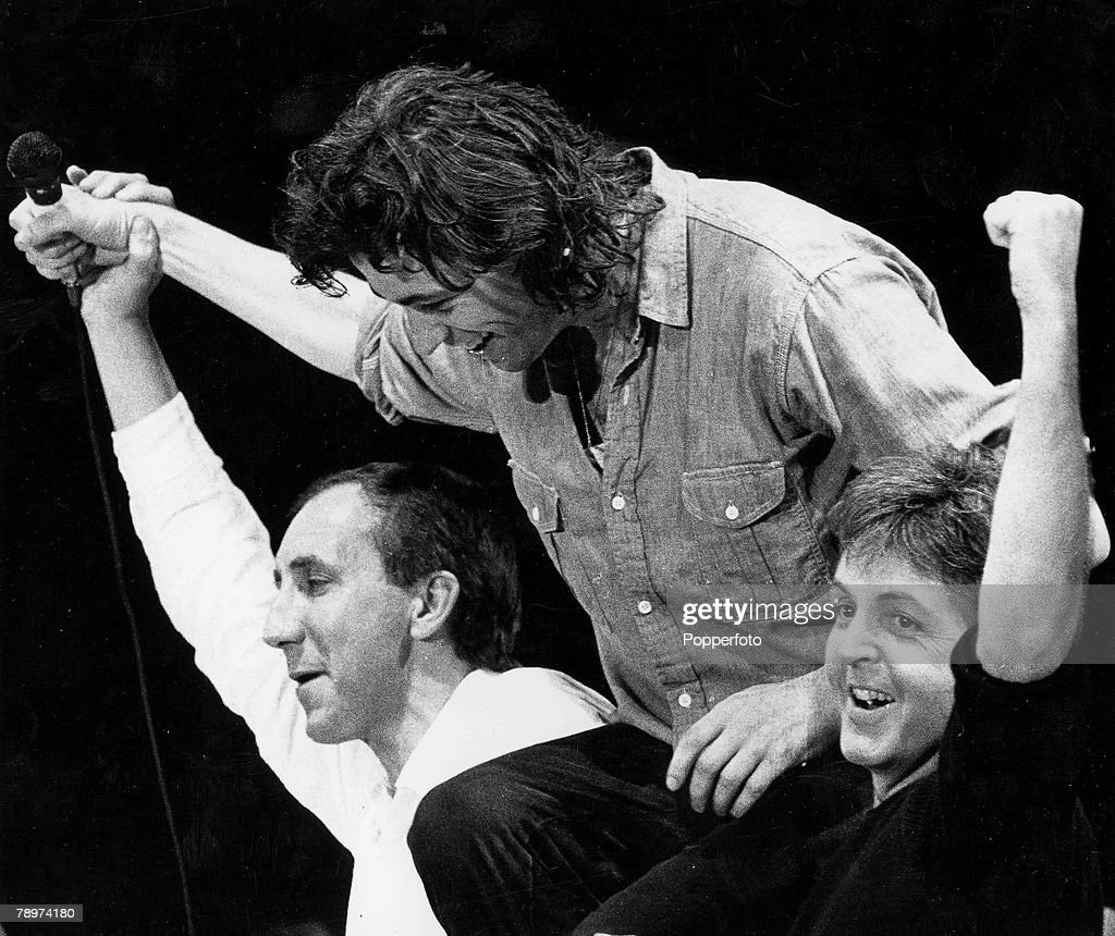 13th July 1985, Wembley Stadium, London, Pictured at the end of the Live Aid concert is Band Aid founder Bob Geldof who is hoisted shoulders high by Rock superstars Pete Townshend (left) of The Who and <a gi-track='captionPersonalityLinkClicked' href=/galleries/search?phrase=Paul+McCartney&family=editorial&specificpeople=92298 ng-click='$event.stopPropagation()'>Paul McCartney</a>