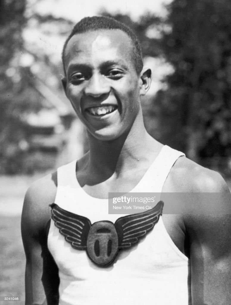 American track athlete Jesse Owens (1913-1980) smiles just after he broke the world record for the 100 meter dash as a high school student, Cleveland, Ohio.