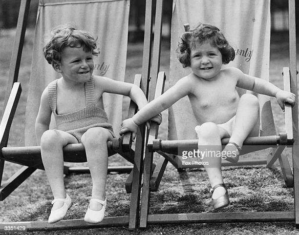 Two little girls in deckchairs keeping cool in the hot sun during a visit to Regent's Park
