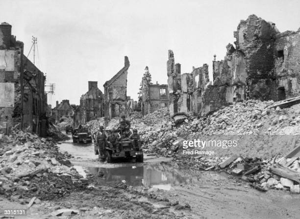 Americans pass through devastated Valognes on their way towards Cherbourg