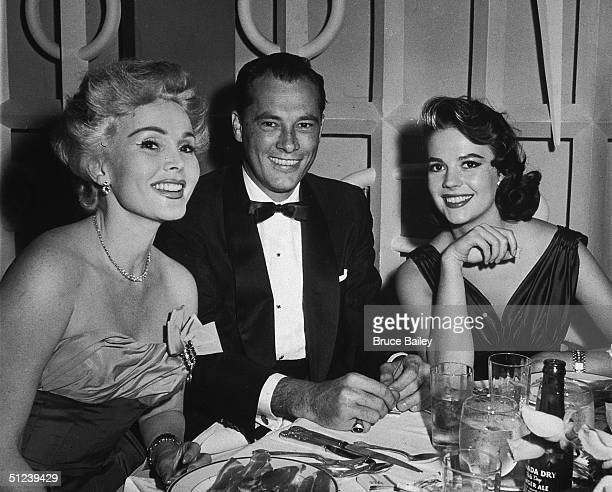 13th June 1957 Hungarianborn actor Zsa Zsa Gabor hotel heir Conrad 'Nicky' Hilton and American actor Natalie Wood at Mike Romanoff's Restaurant They...