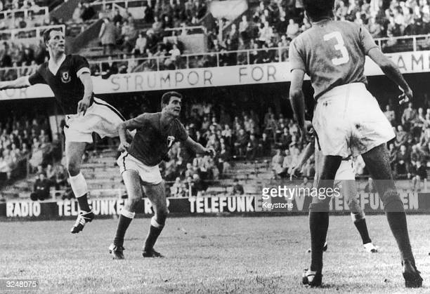Welsh centreforward John Charles makes an attack on the Mexican goal during the WalesMexico World Cup match in Stockholm The match ended in a 11 draw