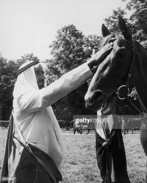 Sheikh Zayed bin Sultan alNahayan ruler of Abu Dhabi at Harvey Leader's racing stables at Newmarket with Kesrawan a horse owned by the Saudi...