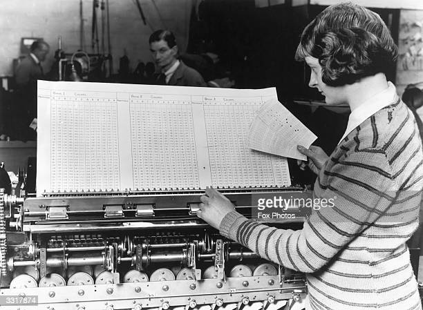 Machines take all the accumulated figures and produce the final statistics for the Census of Great Britain