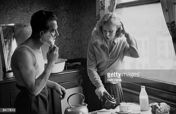 Jim Nolan and his wife Edna at the breakfast table in a scene from a Picture Post fictional serial about the problems an exprisoner has adjusting to...