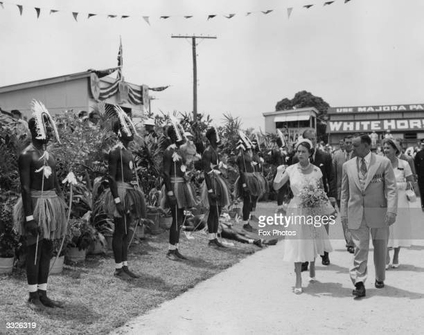 Queen Elizabeth II walking past a guard of honour formed by the Torres Strait Islanders during her visit to Cairns the northern most town on her tour...